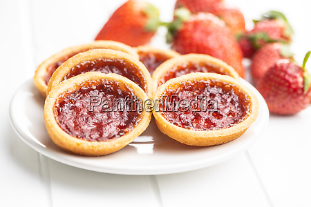 sweet biscuits with strawberries jam