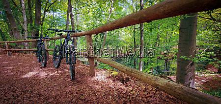 two mountain bikes propped on a