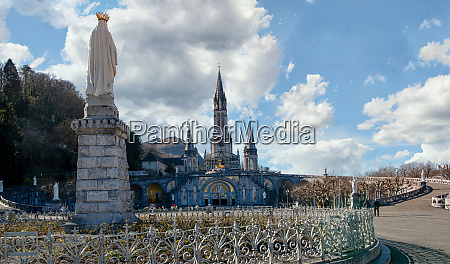 virgin of lourdes on the blue