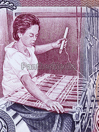 woman weaving a rug a portrait