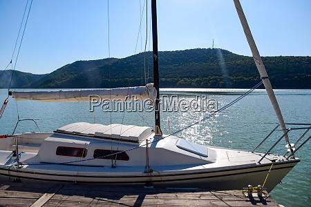 yacht on pier near the shore