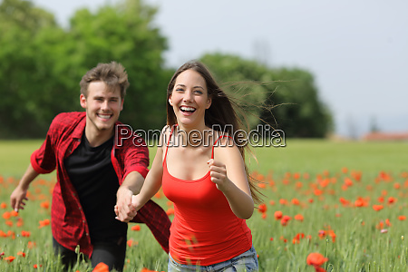 happy couple running and flirting on