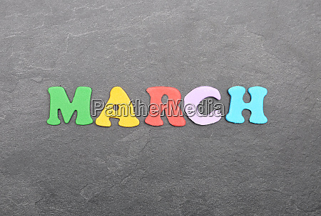 term from colorful letters on slate