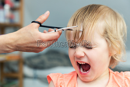 little, girl, screaming, while, mother, doing - 28465668