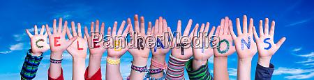 children hands building word celebrations blue