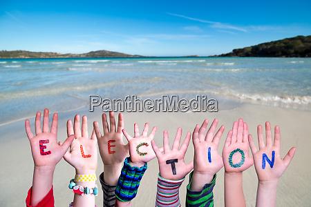 children hands building word election ocean