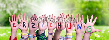 children hands building word erziehung means