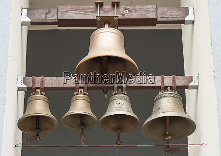 copper bells on a church building