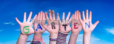 children hands building word garten means