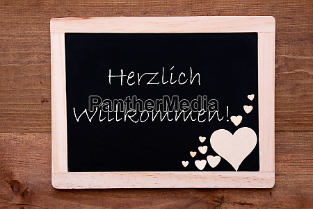 balckboard with wooden heart decoration text