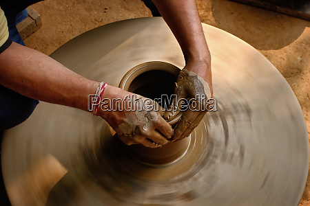 pottery skilled wet hands of
