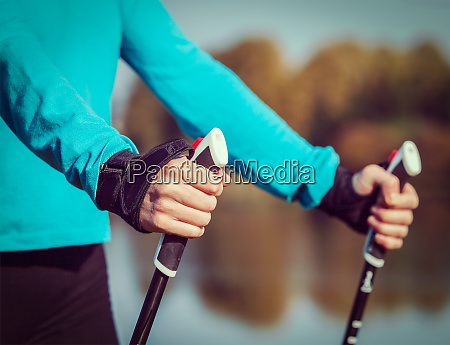 womans hand holding nordic walking poles