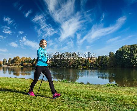 young woman nordic walking