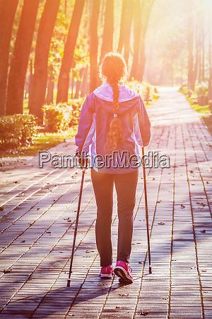 woman nordic walking outdoors