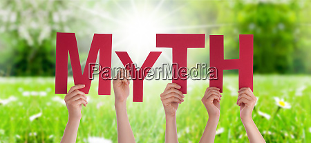 people hands holding word myth grass