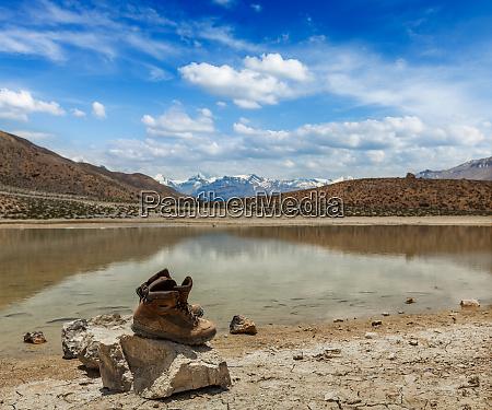 trekking hiking boots at mountain lake