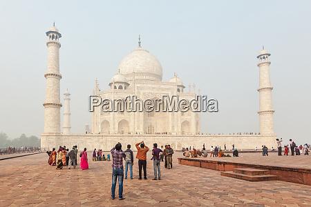 tourists visit taj mahal famous