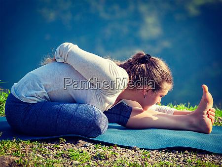woman doing yoga asana outdoors
