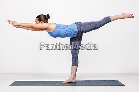 sporty woman practices yoga asana