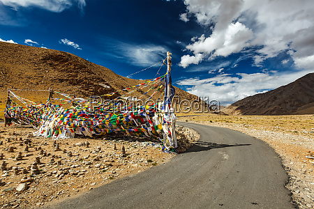 road and buddhist prayer flags lungta