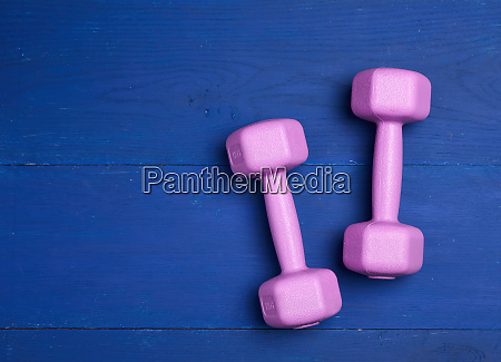 pair pink plastic dumbbells of one