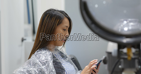 woman with hair treatment in beauty