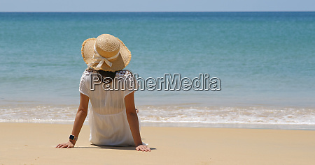 woman sit on beach enjoy sea