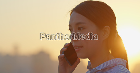 woman talk to mobile phone in