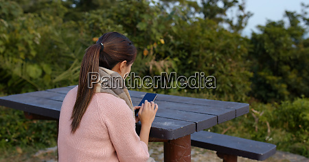 woman check on mobile phone at