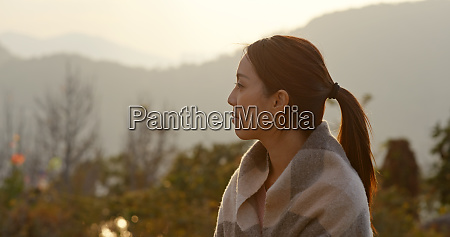 woman look at the countryside at