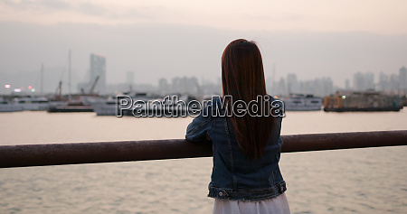 woman look at the sunset sea