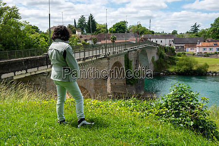 woman looking ancient bridge over the