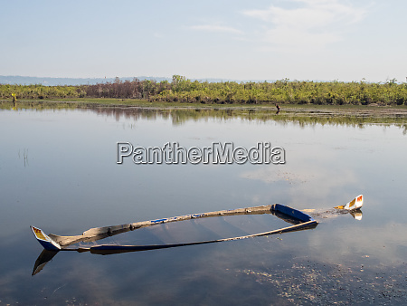 small sunken boat siem reap