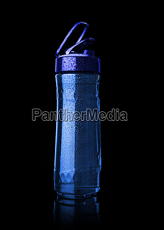 plastic blue sports bottle is covered