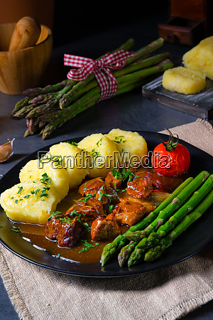 dumplings with beef goulash and green