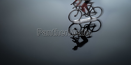 pewter cyclist blurred velocity in back