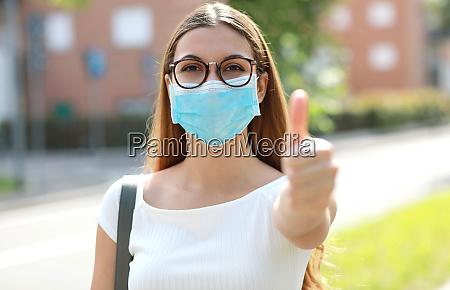 portrait of optimistic girl wearing protective