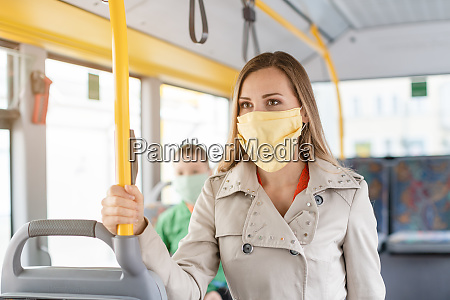 woman using public transport during covid