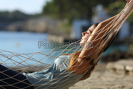 relaxed woman resting on a hammock