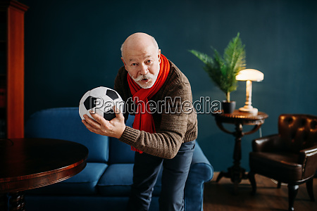 elderly man with red scarf and