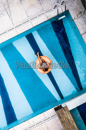 aerial view of woman floating on