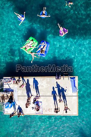 aerial view of people floating in