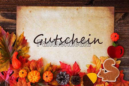 old paper with autumn decoration gutschein