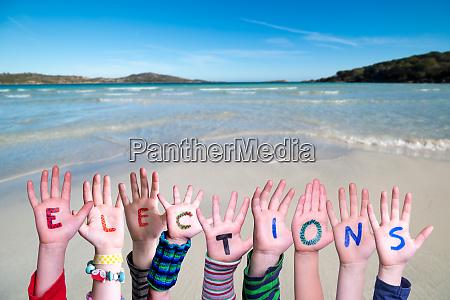 children hands building word elections ocean