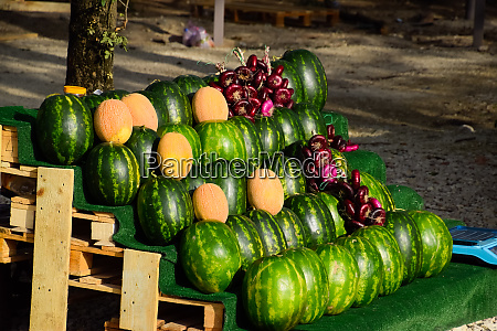 selling vegetables and watermelons by road