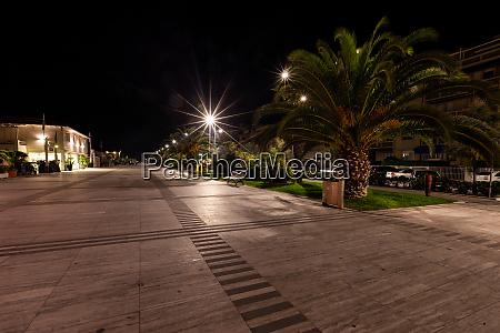 a deserted promenade in lido di