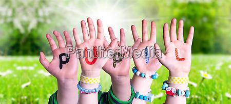 children hands building word pupil grass