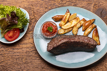 grilled steak with frech fries on