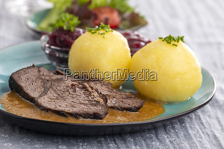 german sauerbraten on a plate with