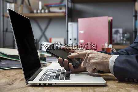 successful businessman sitting at a table